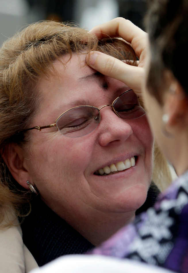 Patricia Miguel has ashes placed on her forehead by Associate Pastor Leslie Welton, outside the St. John's Lutheran Church in Sacramento, Calif., Wednesday March 5,  2014.  In celebration of Ash Wednesday, the pastors at St. John's joined other churches in providing Ashes On The Go for those who want to participate in the start of the Christian observance of Lent but are unable to attend a full church service.  Ash Wednesday marks the beginning of the Lenten season, a time when Christians commit to acts of penitence and prayer in preparation for Easter Sunday.(AP Photo/Rich Pedroncelli)