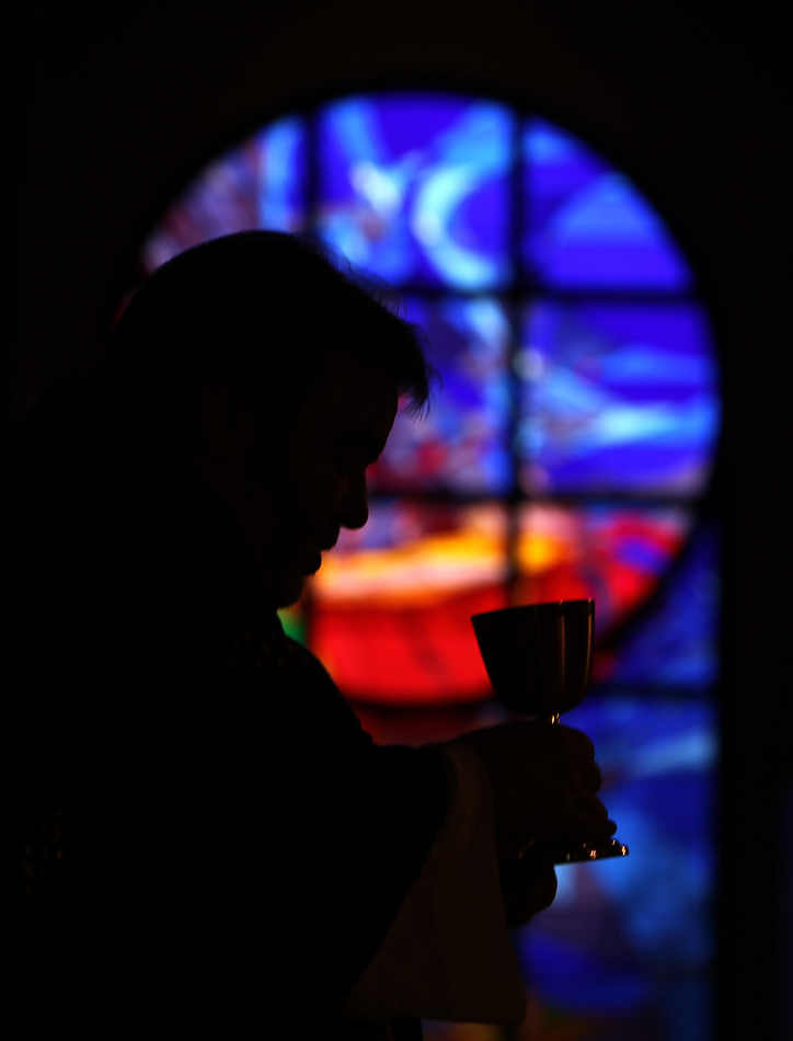 Rev. Tom Rafferty leads communion during an Ash Wednesday service at St. Anthony of Padua Catholic Church in The Woodlands, Texas, Wednesday, March 5, 2014.  Ash Wednesday marks the beginning of the Lenten season, a time when Christians commit to acts of penitence and prayer in preparation for Easter Sunday.  (AP Photo/ The Courier, Jason Fochtman)  MANDATORY CREDIT