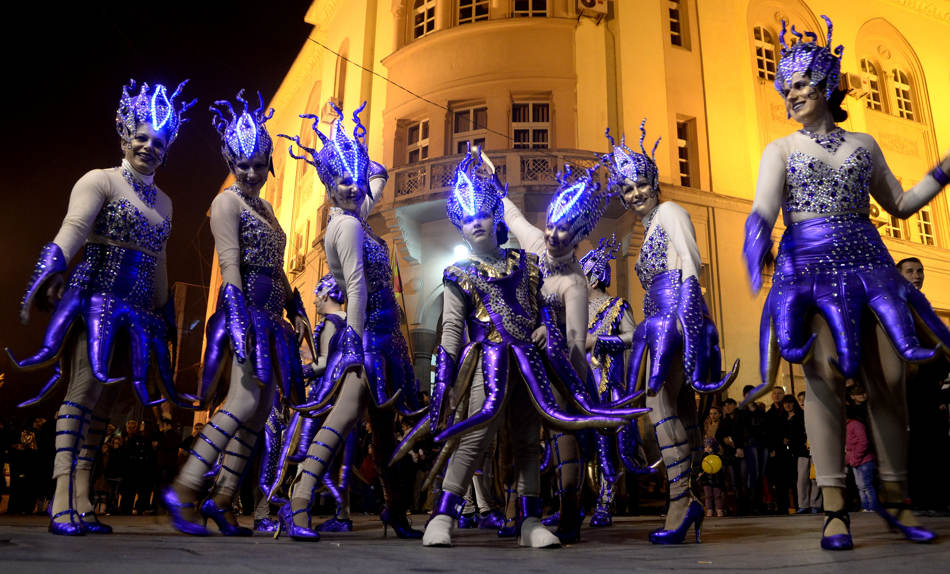Costumed revelers perform during the carnival procession in the southeastern Macedonia's town of Strumica, on Saturday, March 1, 2014. Some 2.500 disguised people participated Saturday, on the main carnival evening in Strumica. (AP Photo/Boris Grdanoski)