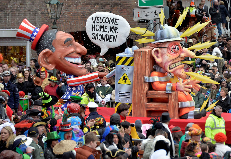 A carnival float depicting US president Barack Obama, left,  putting whistleblower Edward Snowden on an electric chair during the traditional carnival parade in Duesseldorf, western Germany, on Monday, March 3, 2014. The foolish street spectacles in the carnival centers of Duesseldorf, Mainz and Cologne, watched by hundreds of thousands of people, are the highlights in Germany's carnival season on Rose Monday. (AP Photo/Martin Meissner)