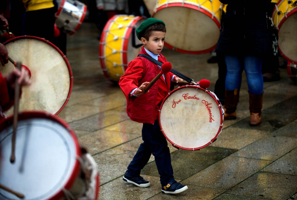 A young drummer  participates in a Carnival parade in Barcelos, northern Portugal, Sunday, March 2, 2014. (AP Photo/Paulo Duarte)