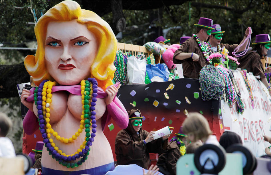 One of the floats in the Tucks Mardi Gras parade moves through the streets in New Orleans, Saturday, March 1, 2014. This is the last full weekend of the Mardi Gras season which will end on Tuesday. (AP Photo/Bill Haber)