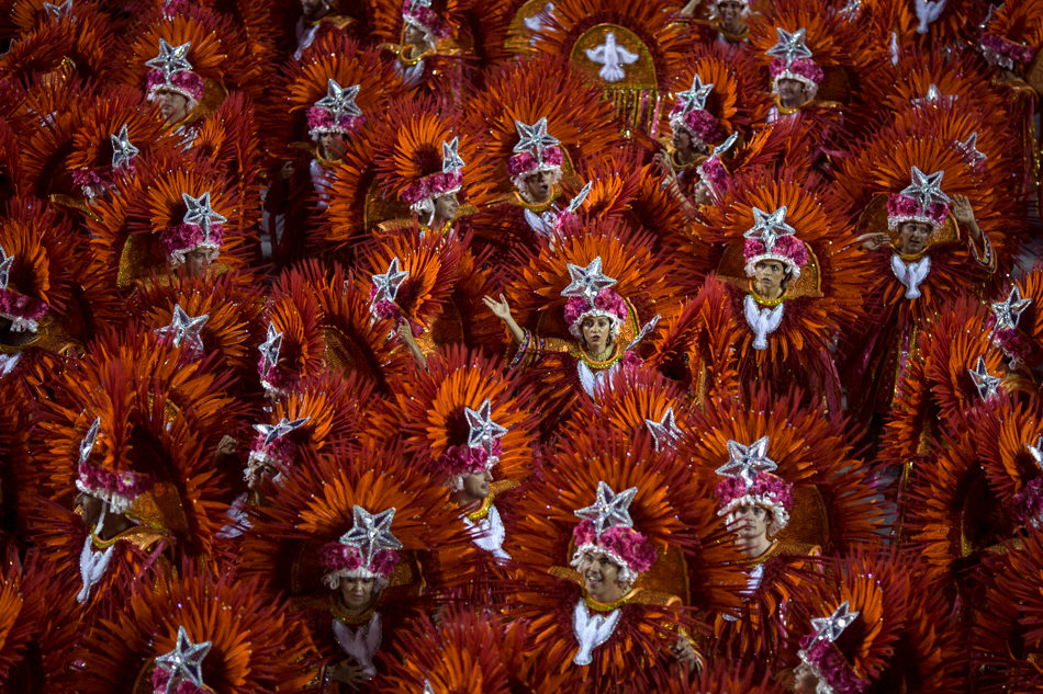 Performers from the Mangueira samba school parade during carnival celebrations at the Sambadrome in Rio de Janeiro, Brazil, Monday, March 3, 2014. (AP Photo/Felipe Dana)