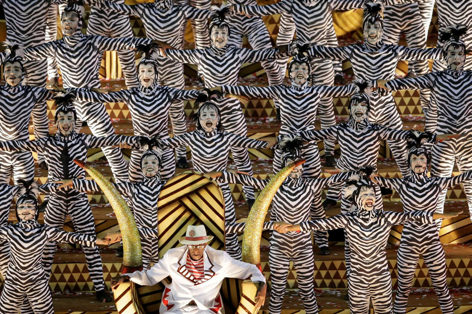 Performers from the Salgueiro samba school parade on a float during carnival celebrations at the Sambadrome in Rio de Janeiro, Brazil, Monday, March 3, 2014. (AP Photo/Felipe Dana)