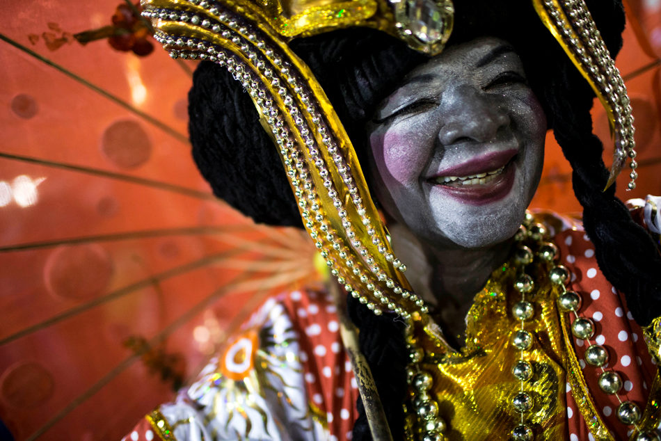 A performer from the Imperatriz Leopoldinense samba school parades during carnival celebrations at the Sambadrome in Rio de Janeiro, Tuesday, March 4, 2014. Brazil's Carnival is maintaining its frenetic pace, with hundreds of roving parties taking over Rio de Janeiro's streets and famed samba school parades heading into their final night. (AP Photo/Felipe Dana)