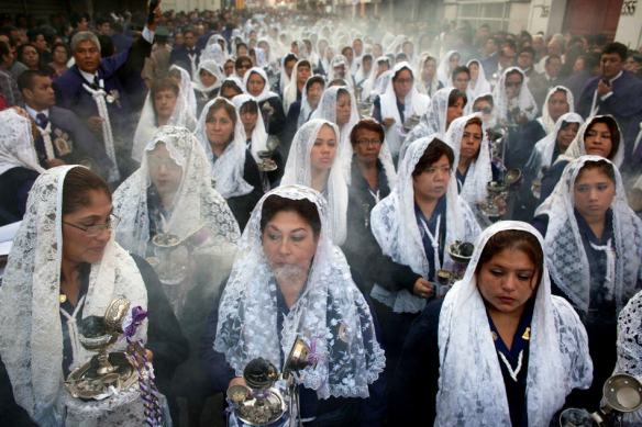 "Women burn incense while participating in a Good Friday procession honoring ""The Lord of Miracles"", the patron saint of Lima, Peru, on Friday, April 18, 2014. Christians all over the world are marking Good Friday, the day when Jesus Christ was crucified. (AP Photo/Rodrigo Abd)"