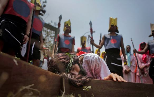 A Christian devotee enacts the crucifixion of Jesus Christ to mark Good Friday in Gauhati, India, Friday, April 18, 2014. Christians all over the world are marking Good Friday, the day when Jesus Christ was crucified. (AP Photo/Anupam Nath)