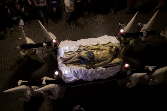 Penitents of the Jesus Yacente brotherhood carry a Jesus Christ figure as they take part in a Holy Week procession in Zamora, northern Spain Thursday, April 17, 2014. Hundreds of processions take place throughout Spain during the Easter Holy Week. (AP Photo/Andres Kudacki)