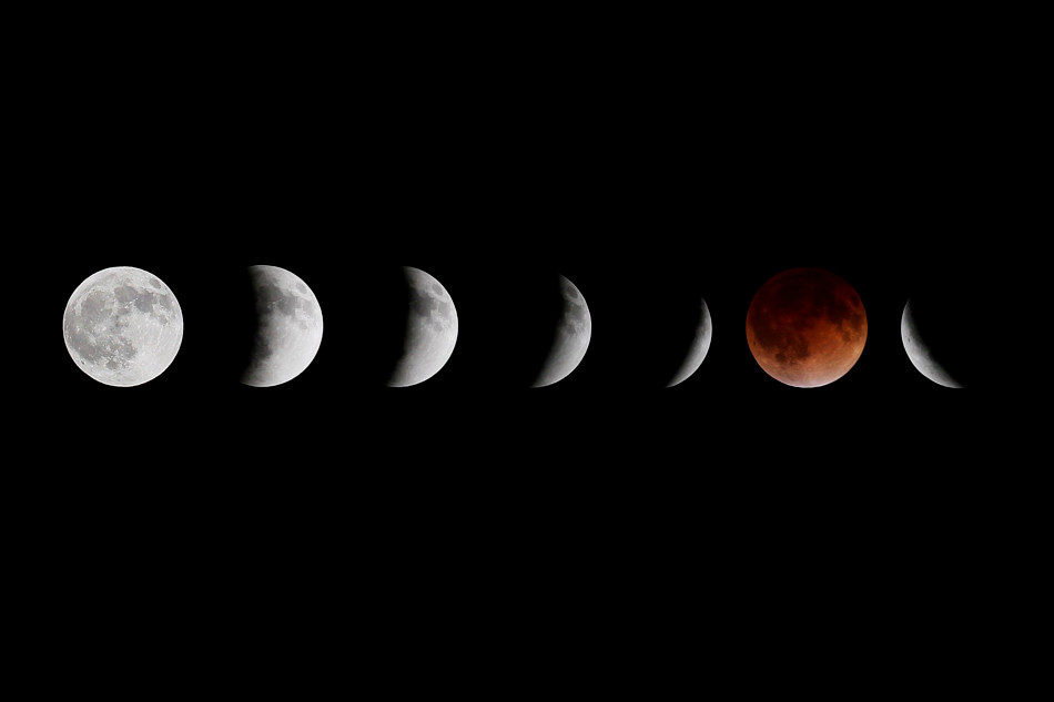 This composite photo shows multiple images of the moon during the stages of a lunar eclipse, as seen from Winnipeg, Manitoba, Tuesday, April 15, 2014. (AP Photo/The Canadian Press, John Woods)