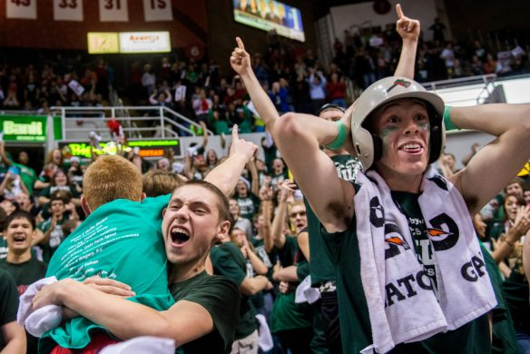 FRED ZWICKY/JOURNAL STAR Bedlam breaks out as Lincoln fans Gage Vinson, facing at left, and Hank Freed, right, cheer during their Class 3A state basketball semifinal game against  Rockford on Friday, March 21 at the Peoria Civic Center.