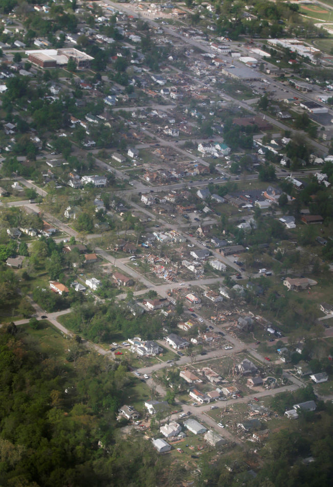 A tornado's path is seen in an aerial photo made over Baxter Springs, Kan., Monday, April 28, 2014. A tornado damaged dozens of buildings and injured at least 25 people on Sunday. (AP Photo/Orlin Wagner)