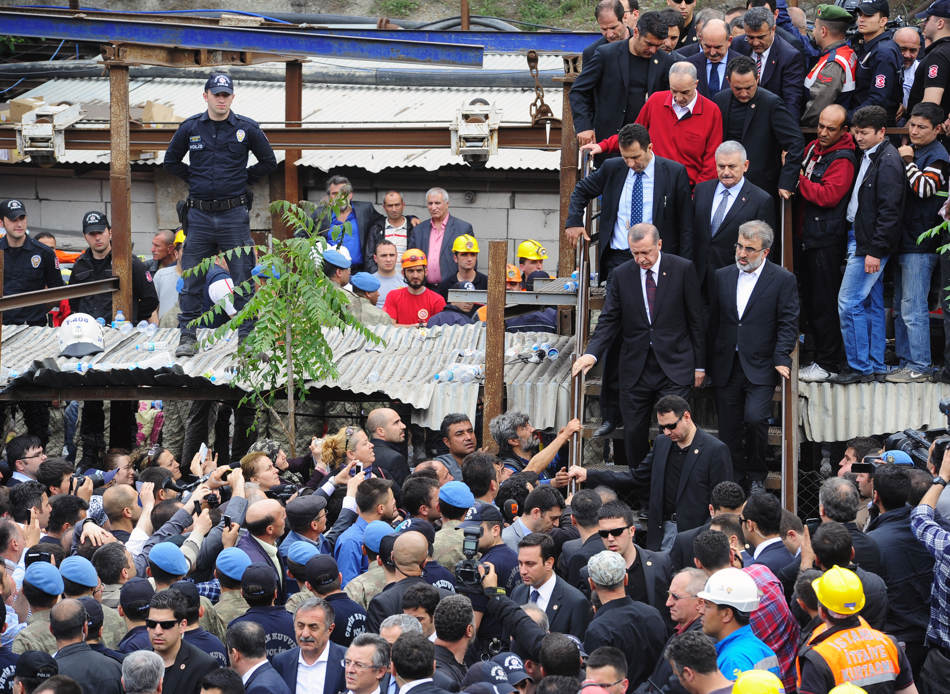 Turkey's Prime Minister Recep Tayyip Erdogan, walks down steps, second row left,   center-right, is surrounded by security members as he visits the coal mine in Soma, western Turkey, some 250 kilometers (155 miles) south of Istanbul, early Wednesday, May 14, 2014. An explosion and fire at the coal mine killed at least 232 workers, authorities said, in one of the worst mining disasters in Turkish history. Turkey's Energy Minister Taner Yildiz said 787 people were inside the coal mine at the time of the accident. (AP Photo/Emre Tazegul)
