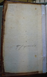 Inscription on front pastedown (Note: the brown staining is from leather binding and the hinge tape from a prior owner's repair)