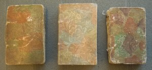 The Three Baldwin variations (arranged earliest to latest from left to right, in their appealing Dutch Paper wrappers. (Cotsen New Acquisition)