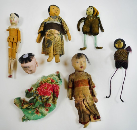 As you can tell, some dolls are in far better shape than others. The center of the imageshows what remains of a doll's head and her dress.