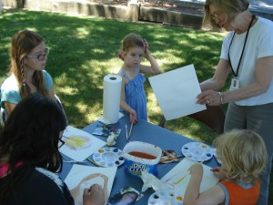 Anne Brooke encourages the kids trying their hand at watercolors.