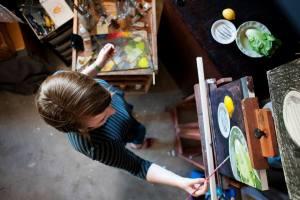 Sarah Burns - painting in her studio