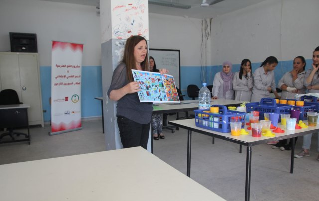 Art Therapy Helps Syrian Children Recover from Trauma of War: Anita Toutikian leading a class of Syrian children in Lebanon. Image by John Knefel.