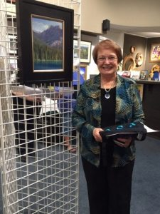 """Carla J Griffin with """"Emerald Lake,"""" winner of the 2015 Pastel Society of Oregon Award of Distinction"""