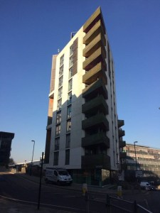 An image of One Brighton, which is ten stories high.