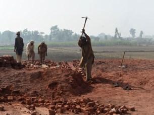 Pakistani labourers work at a brick factory. PHOTO: AFP