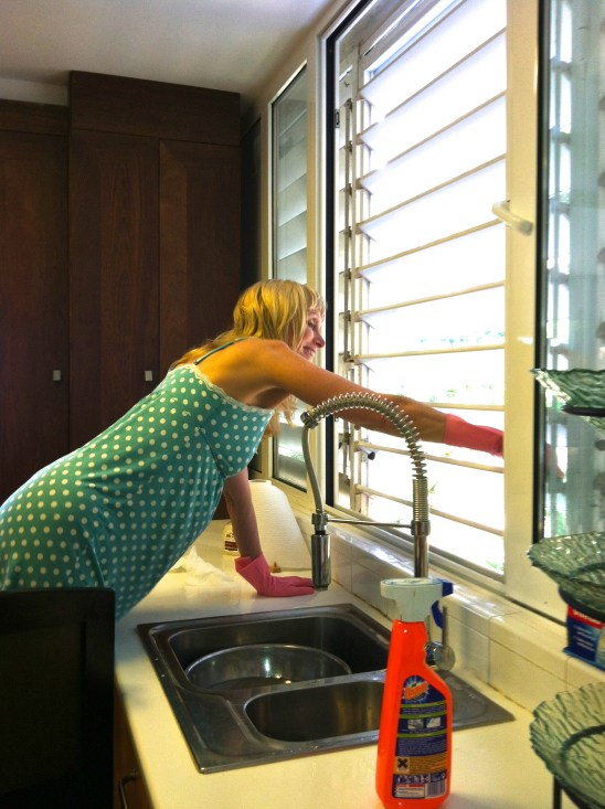 Blonde woman cleaning kitchen