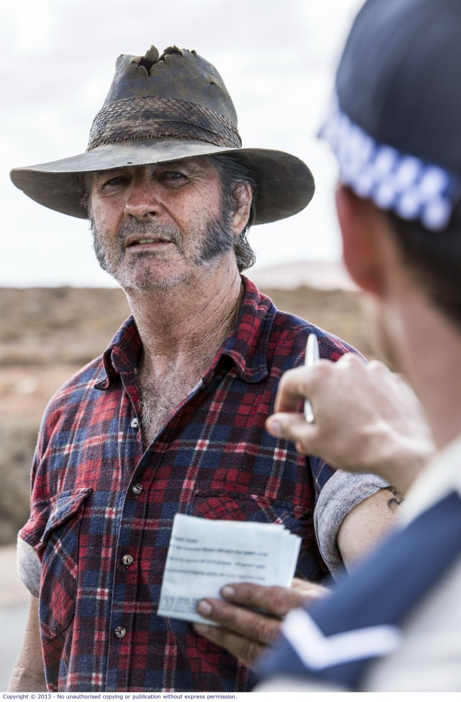 WolfCreek2_John Jarrat as Mick Taylor_run in with police