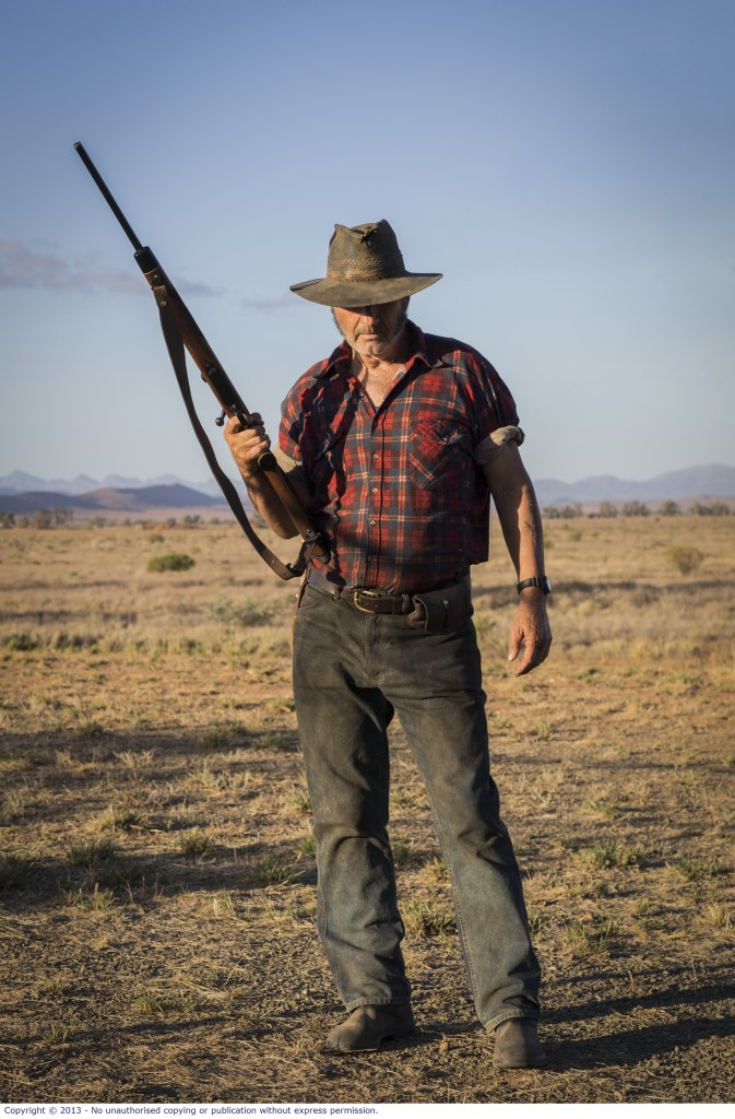 WolfCreek2_John Jarratt as Mick Taylor with gun 7