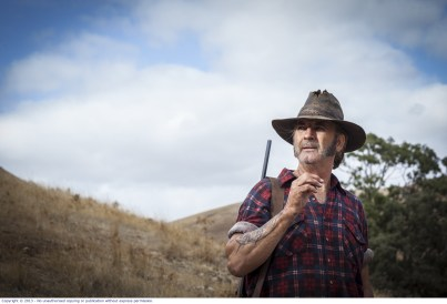 WolfCreek2_John Jarratt as Mick Taylor_ with gun _ from below 2