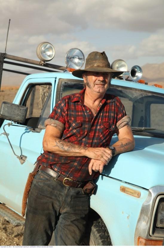 WolfCreek2_John Jarratt as Mick Taylor_with his hunting ute