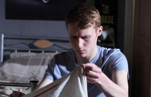 Programme Name: EastEnders - TX: 10/07/2012 - Episode: n/a (No. 4459) - Embargoed for publication until: 03/07/2012 - Picture Shows: Jay finds the photo frame that killed Heather Jay Mitchell (Jamie Borthwick) - (C) BBC - Photographer: Jack Barnes