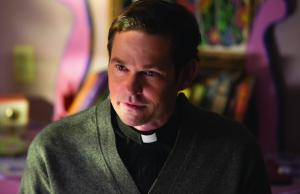 "HENRY THOMAS as Father Tom in ""Ouija: Origin of Evil.""  Inviting audiences again into the lore of the spirit board, the supernatural thriller tells a terrifying new tale as the follow-up to 2014's sleeper hit that opened at No. 1.  In 1965 Los Angeles, a widowed mother and her two daughters add a new stunt to bolster their séance scam business and unwittingly invite authentic evil into their home.  When the youngest daughter is overtaken by the merciless spirit, this small family confronts unthinkable fears to save her and send her possessor back to the other side."