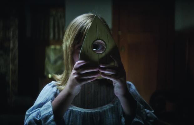 """LULU WILSON as Doris in """"Ouija: Origin of Evil.""""  Inviting audiences again into the lore of the spirit board, the supernatural thriller tells a terrifying new tale as the follow-up to 2014's sleeper hit that opened at No. 1.  In 1965 Los Angeles, a widowed mother and her two daughters add a new stunt to bolster their séance scam business and unwittingly invite authentic evil into their home.  When the youngest daughter is overtaken by the merciless spirit, this small family confronts unthinkable fears to save her and send her possessor back to the other side."""