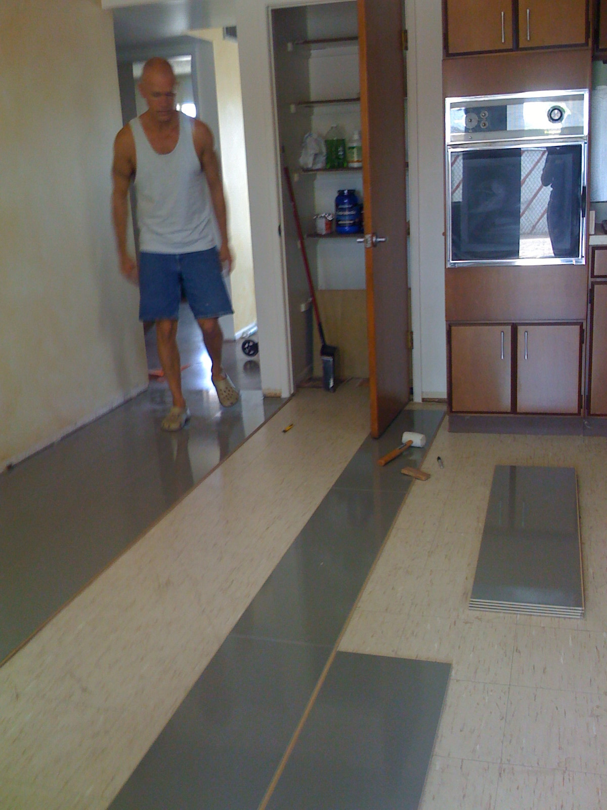 beautiful new flooring in the kitchen laminate flooring in kitchen It s a simple click in place floor no adhesive no underlayment required It took us about four hours to install it in the sf kitchen