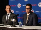 TORONTO, CANADA - DECEMBER 4: President Mark Shapiro looks on as Ross Atkins speaks to the media as Atkins is introduced as the new general manager of the Toronto Blue Jays during a press conference on December 4, 2015 at Rogers Centre in Toronto, Ontario, Canada. (Photo by Tom Szczerbowski/Getty Images)