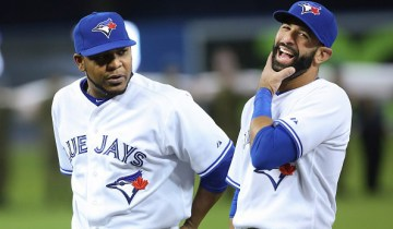 TORONTO, ON - APRIL 13: During player introductions, Toronto Blue Jays right fielder Jose Bautista (19) has a big laugh beside Toronto Blue Jays first baseman Edwin Encarnacion (10).  The Toronto Blue Jays took on the Tampa Bay Rays in the Jays' home opener at the Rogers Centre.