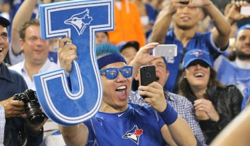 TORONTO, ON- OCTOBER 14:   Jays Fans were excited about the win. The Toronto Blue Jays and Texas Rangers play game four of the MLB American League Division Series . at  Rogers Centre in Toronto.  October 14, 2015.        (Steve Russell/Toronto Star via Getty Images)