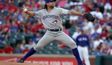 ARLINGTON, TX - MAY 13:  R.A. Dickey #43 of the Toronto Blue Jays pitches against the Texas Rangers in the bottom of the first inning at Globe Life Park in Arlington on May 13, 2016 in Arlington, Texas.  (Photo by Tom Pennington/Getty Images)