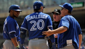 MINNEAPOLIS, MN - MAY 21: Josh Donaldson #20 of the Toronto Blue Jays speaks with home plate umpire Toby Basner #99 after being tossed as teammate Edwin Encarnacion #10 and manager John Gibbons #5 look on during the first inning of the game against the Minnesota Twins on May 21, 2016 at Target Field in Minneapolis, Minnesota. (Photo by Hannah Foslien/Getty Images)