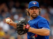 NEW YORK, NY - SEPTEMBER 13: R.A. Dickey #43 of the Toronto Blue Jays in action during the eighth inning against the New York Yankees at Yankee Stadium on September 13, 2015 in the Bronx borough of New York City. (Photo by Adam Hunger/Getty Images)