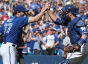 TORONTO, CANADA - JUNE 12: Jason Grilli #37 and Russell Martin #55 of the Toronto Blue Jays celebrate their victory during MLB game action against the Baltimore Orioles on June 12, 2016 at Rogers Centre in Toronto, Ontario, Canada. (Photo by Tom Szczerbowski/Getty Images)