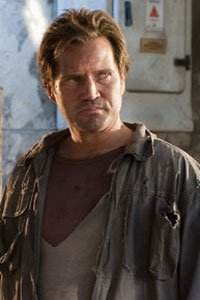 Langley Kirkwood as the AC leader Rudi.