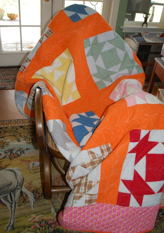 orange quilt on rocker
