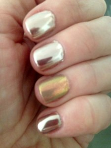 rose gold chrome nails indoors