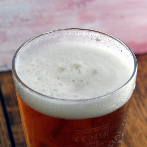 The head on a glass of beer.