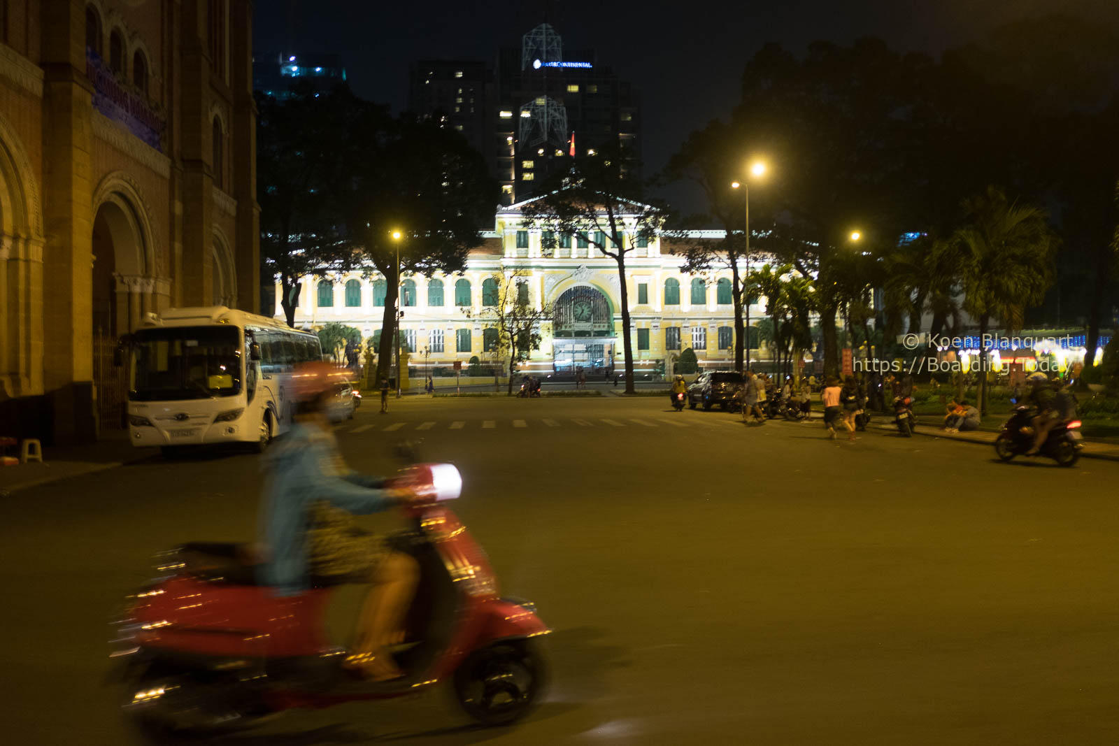 Driving past the central post building in Saigon