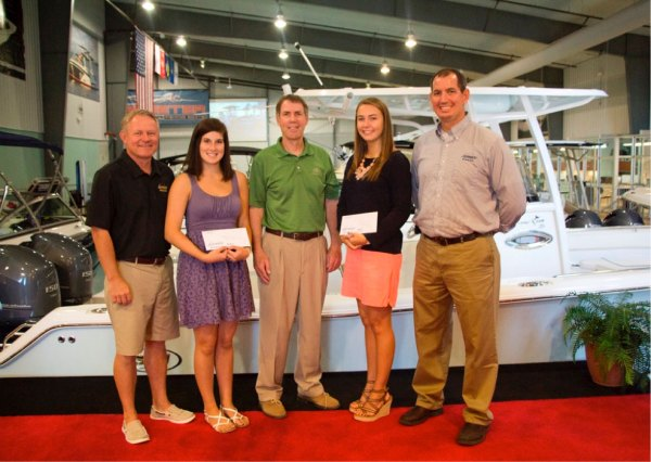Destin and Fort Walton Beach winners of the Legendary Marine Scholarship Awards included Blythe Greene, left and Kerri Andre, right, with Destin Sales Manager Bob Peavler, far left; Legendary Marine Managing Partner Fred Pace, center; and Fort Walton Beach Sales Manager Jeff Henley, far right.