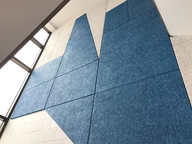 Acoustic panels in the stairwell of our latest office Reno help with sound bouncing between floors and look great! #construction #design #architecture #renovation #interior #acoustic