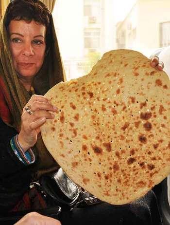 In Iran: Bambi with fresh, warm Persian bread.