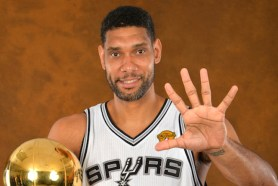 SAN ANTONIO, TX - JUNE 15: TIm Duncan #21 of the San Antonio Spurs poses for a portrait with the Larry O'Brien Trophy after defeating the Miami Heat in Game Five of the 2014 NBA Finals on June 15, 2014 at AT&T Center in San Antonio, Texas. NOTE TO USER: User expressly acknowledges and agrees that, by downloading and or using this photograph, User is consenting to the terms and conditions of the Getty Images License Agreement. Mandatory Copyright Notice: Copyright 2014 NBAE (Photo by Jesse D. Garrabrant/NBAE via Getty Images)